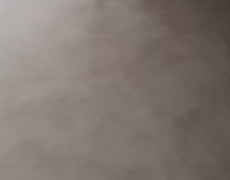 Office floor coated in 'latte/mocha' microcement